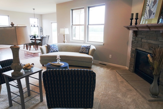 Home staging v interior design premiere home stagers for Staged living room ideas